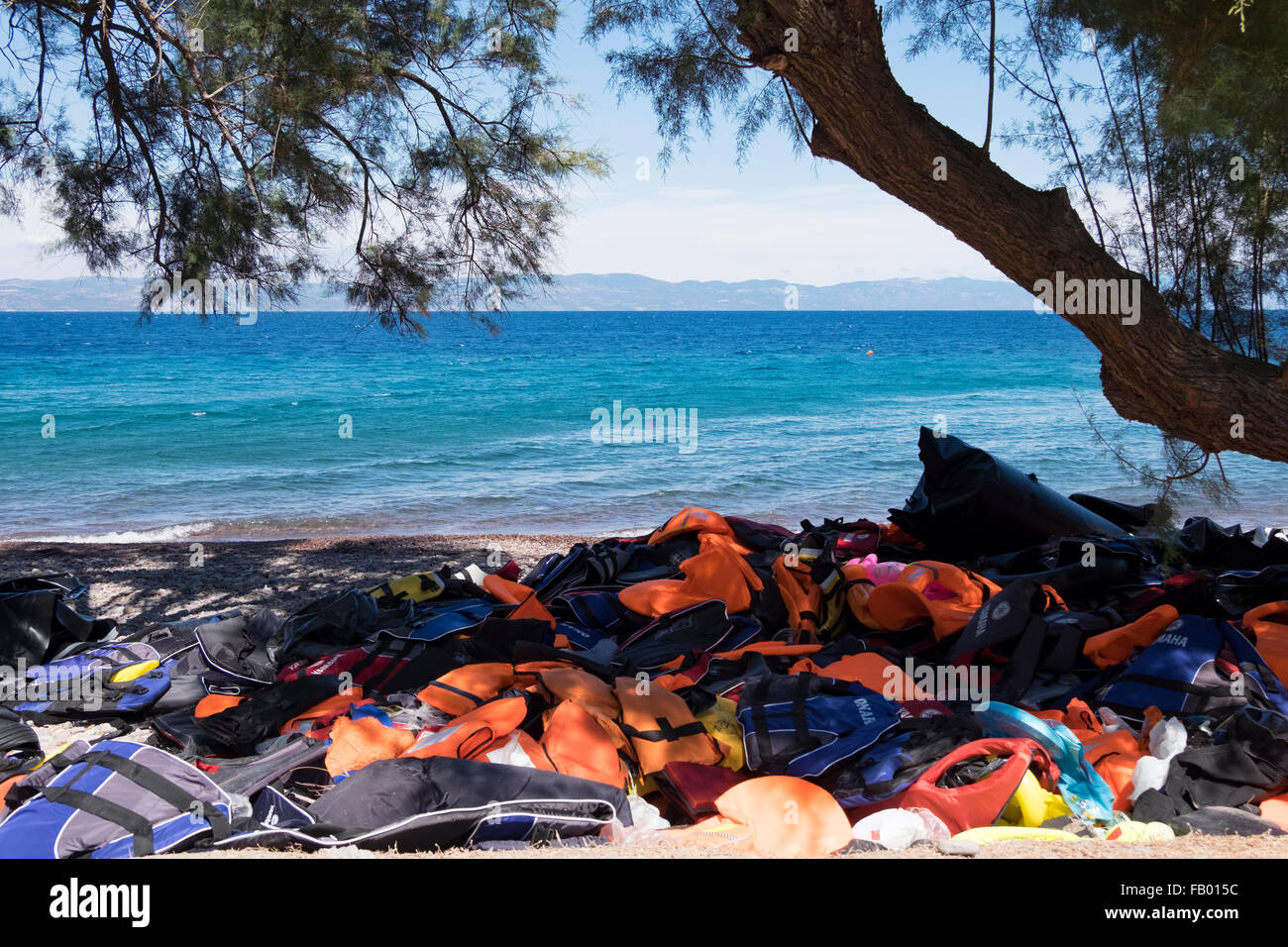 Piles of life jackets on a beach on the island of Lesvos, Greece after being discarded by refugees crossing from - Stock Image