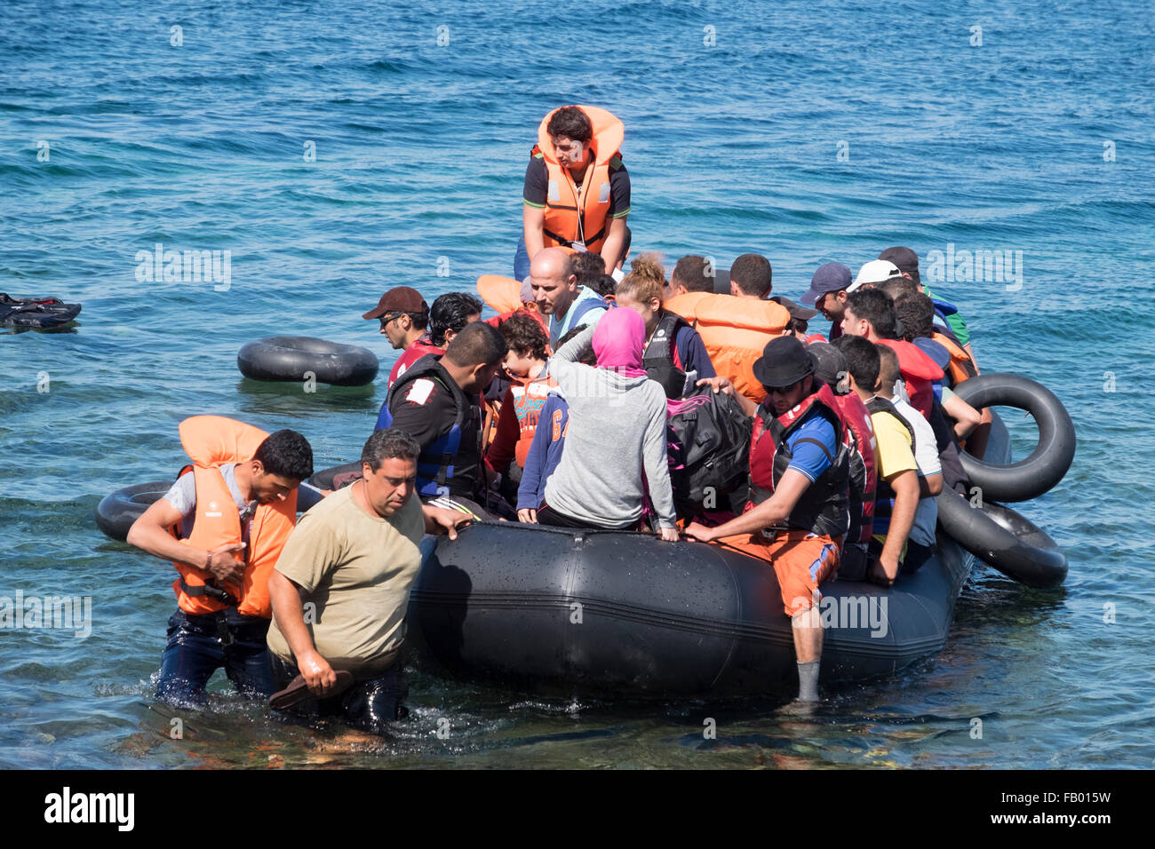 Syrian refugees cross from Turkey in a rubber raft to land on a beach on the Greek island of Lesvos/Lesbos Stock Photo