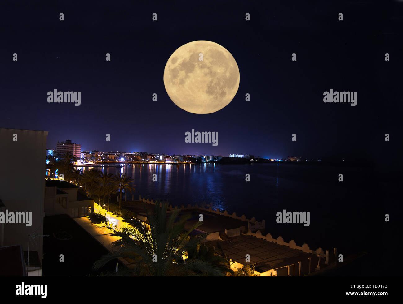 Night seaside view with full shiny moon in Ibiza, Balearic islands, Spain - Stock Image