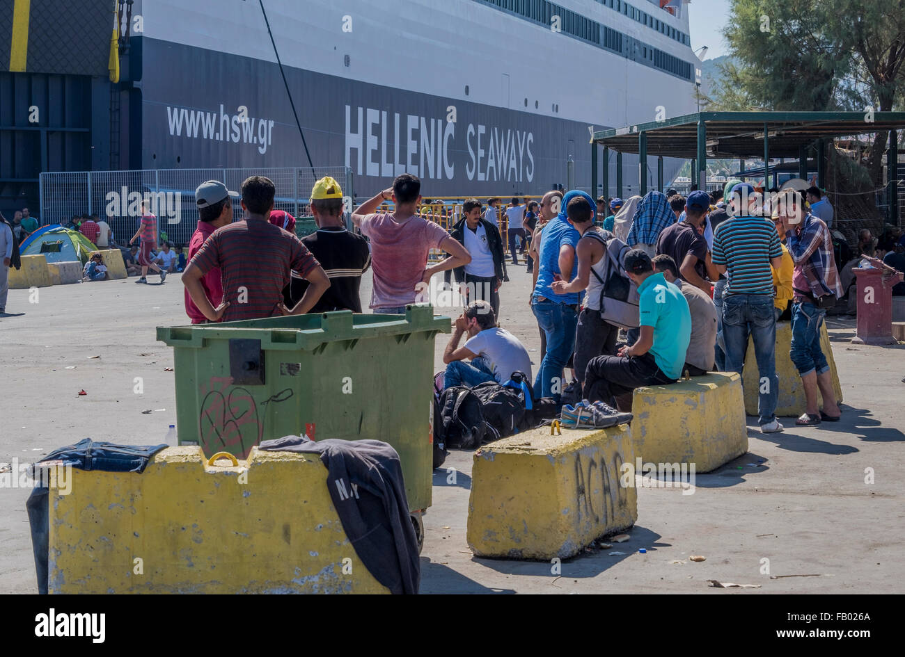 Refugees From Syria And Afghanistan Wait To Board A Greek Ferry