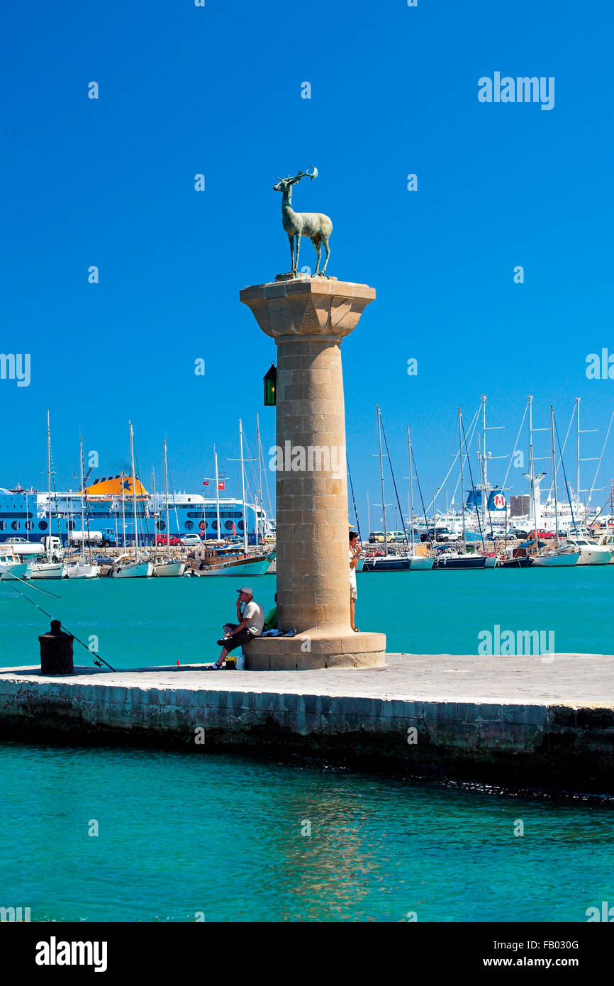 Mandraki harbour and fortress Agios Nicolaos in Rhodes town, Rhodes Island, Greece, UNESCO - Stock Image