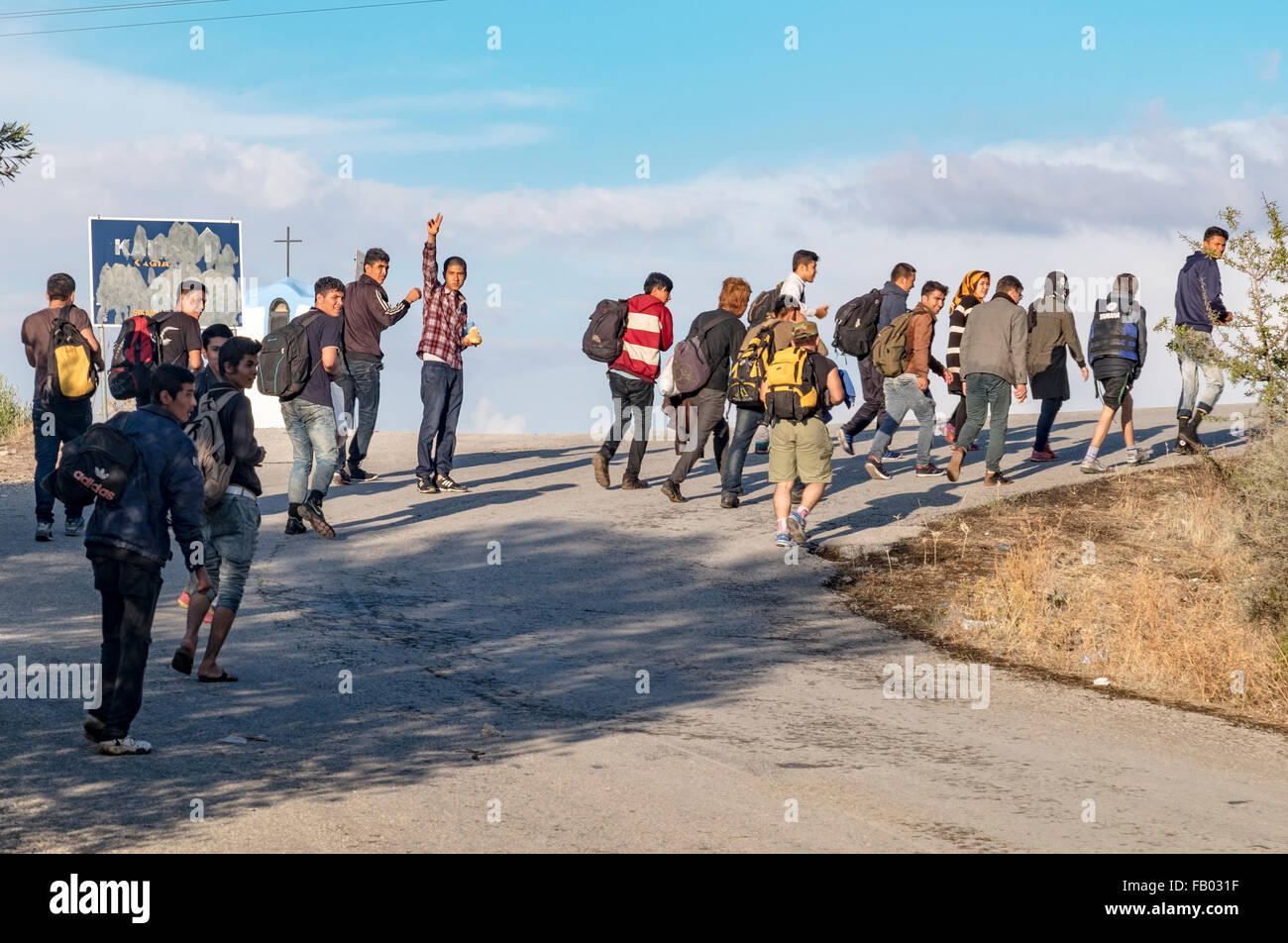 Recently arrived refugees from Afghanistan arrive on the island of Lesvos and begin walking to the capital to be - Stock Image