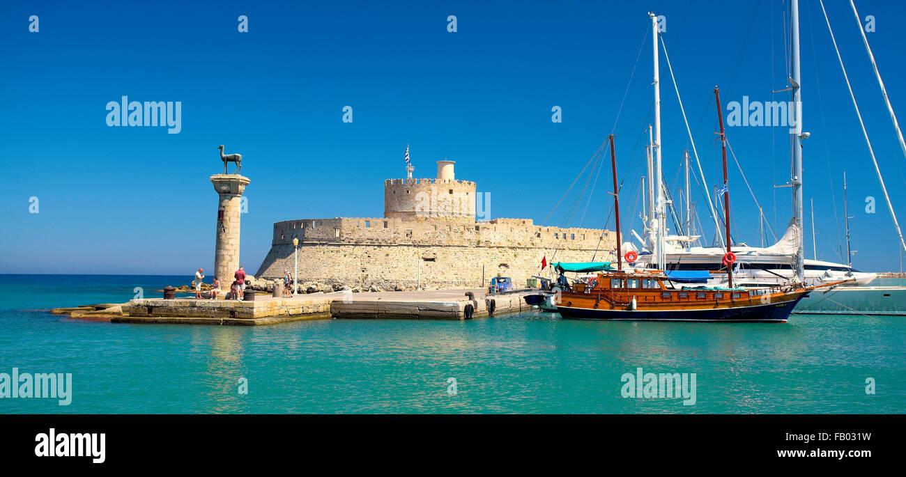 Mandraki harbour and fortress Agios Nicolaos in Rhodes town, Rhodes Island, Greece, UNESCO Stock Photo