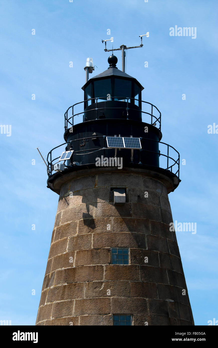 Mount Desert Rock lighthouse is the most remote lighthouse in Maine. Stone tower is equipped with various weather, - Stock Image