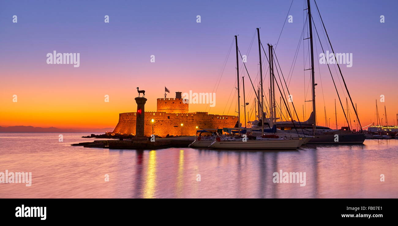 Mandraki harbour and fortress Agios Nicolaos before sunrise, Rhodes town, Rhodes Island, Greece, UNESCO - Stock Image