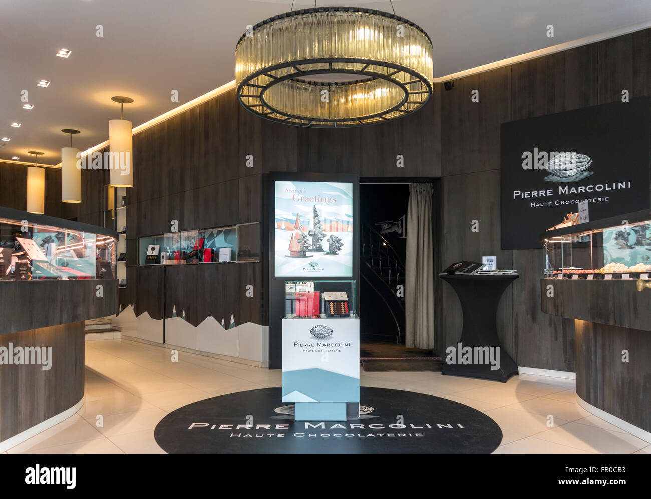 Brussels Belgium. Interior of Chocolatier Pierre Marcolini. Upscale, most expensive, exquisite artisan Belgian chocolates. - Stock Image