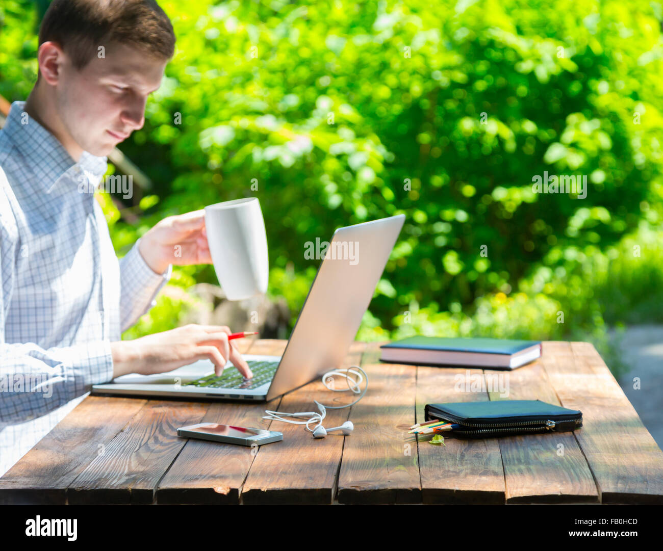 Hardworking man inspired with nature - Stock Image