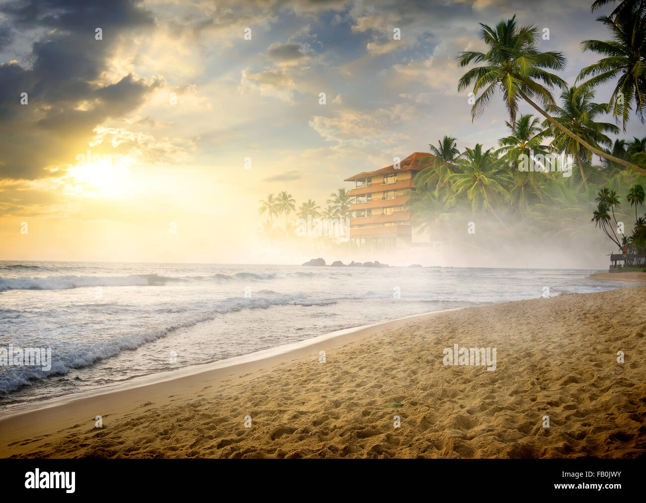 Morning fog over sandy beach of the ocean - Stock Image