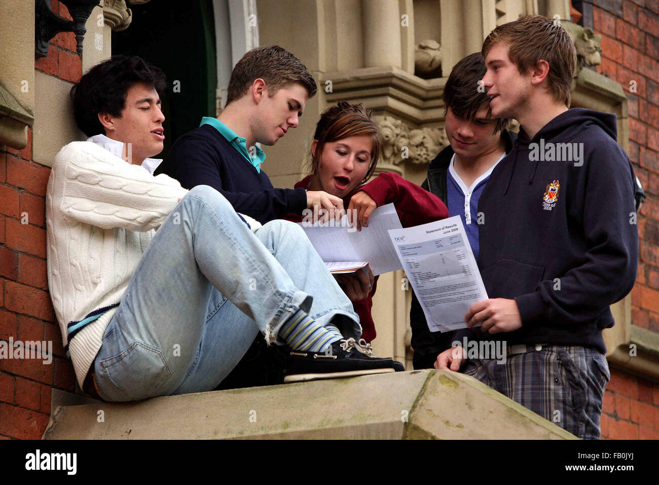 A level results day at Cheadle Hulme School.  Students discuss their results on the school steps. - Stock Image