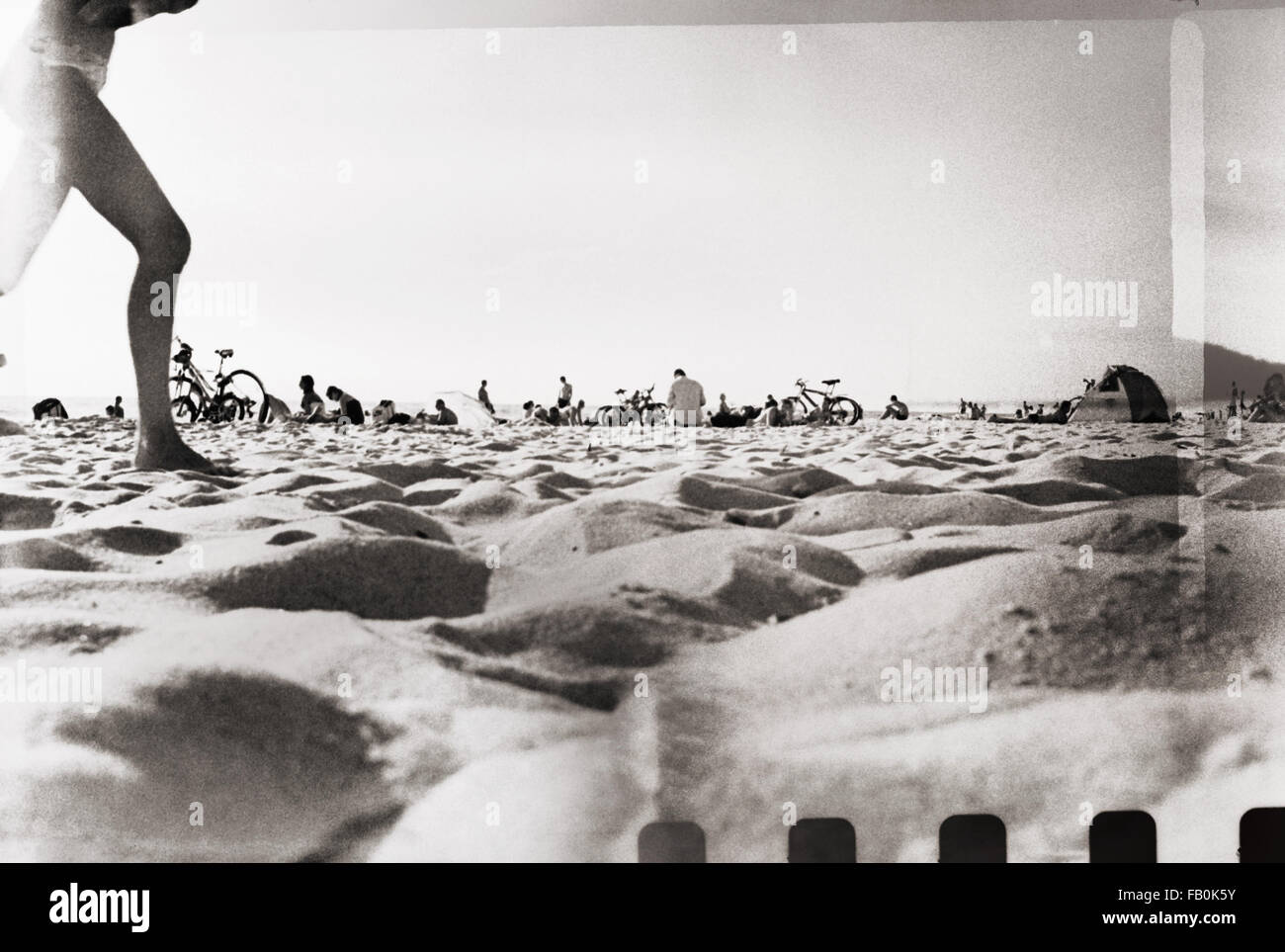 Retro film photo vacation snapshot sunny day on the beach grain blur light leaks added as vintage effect