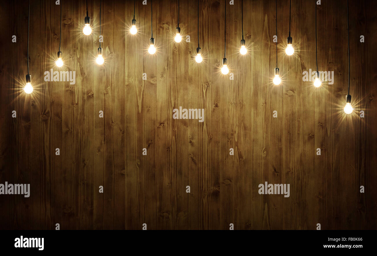 Light bulbs on dark wooden background Stock Photo ...