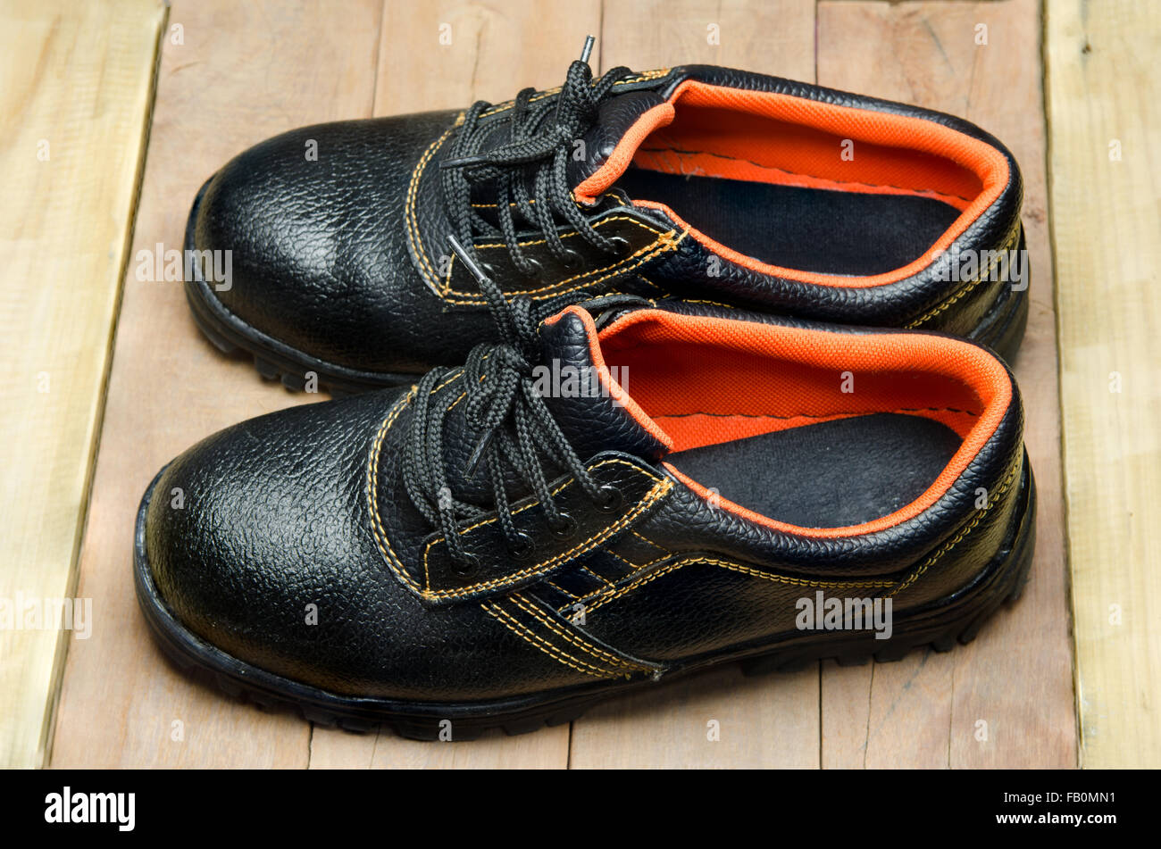 Black Steel Toe Safety of steel cap work boots . - Stock Image