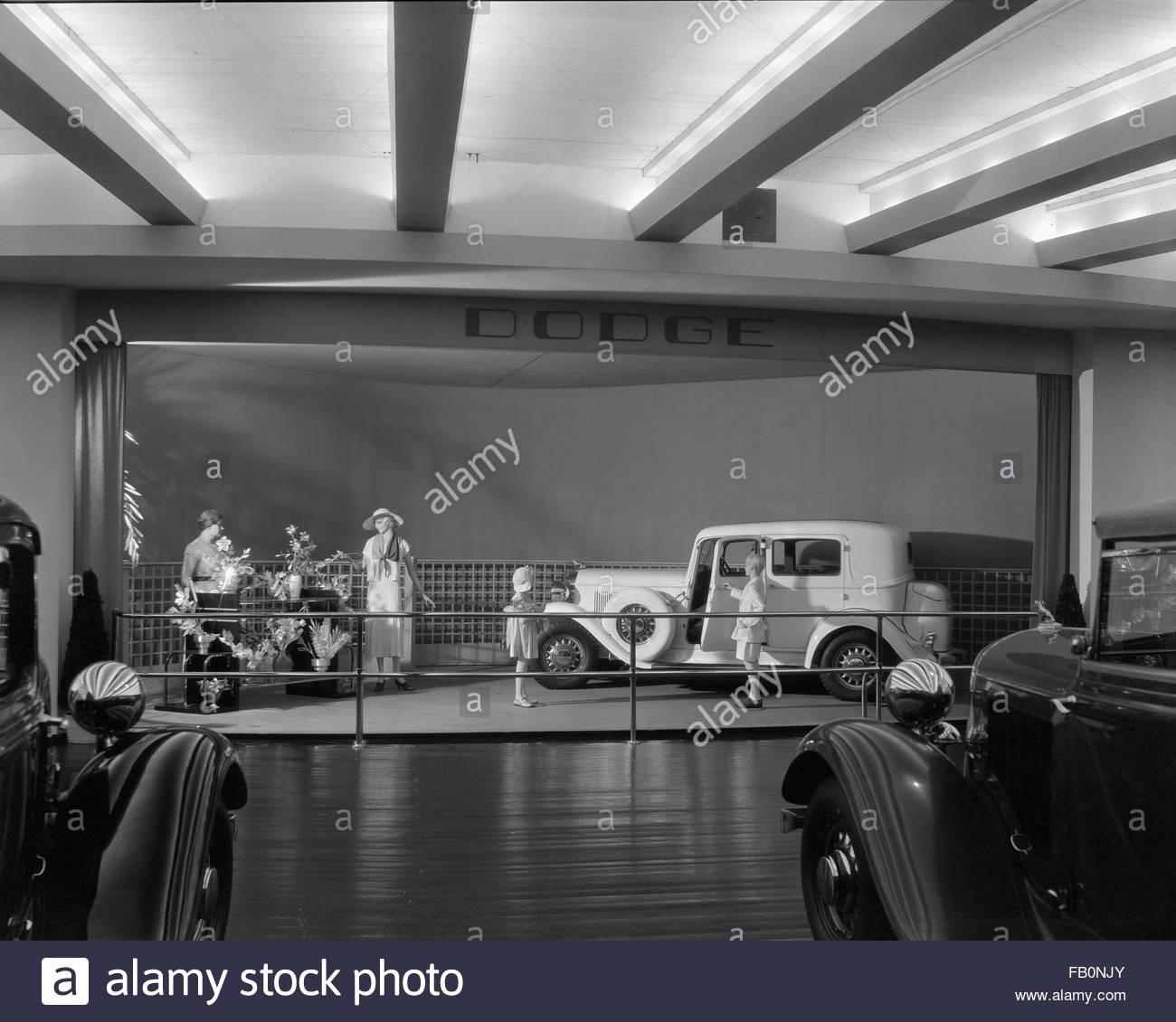 Interior, Dodge exhibit with car and mannequins. Chrysler Motors building at Century of Progress, 1933. - Stock Image