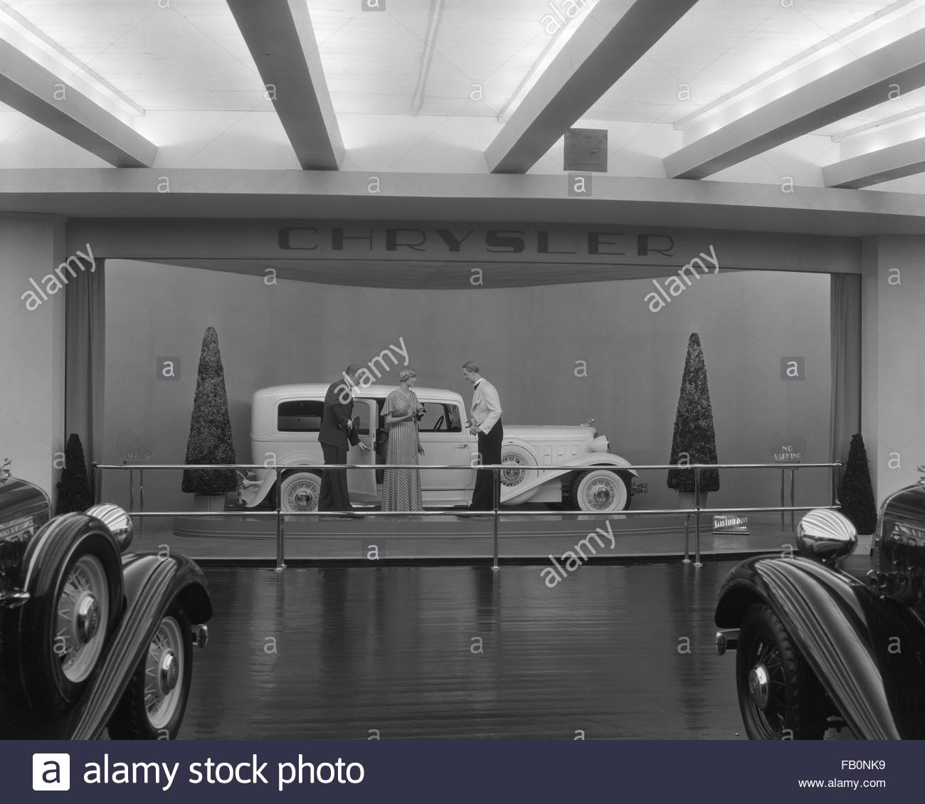 Interior, Chrysler exhibit with car and mannequins. Chrysler Motors building at Century of Progress, 1933. - Stock Image
