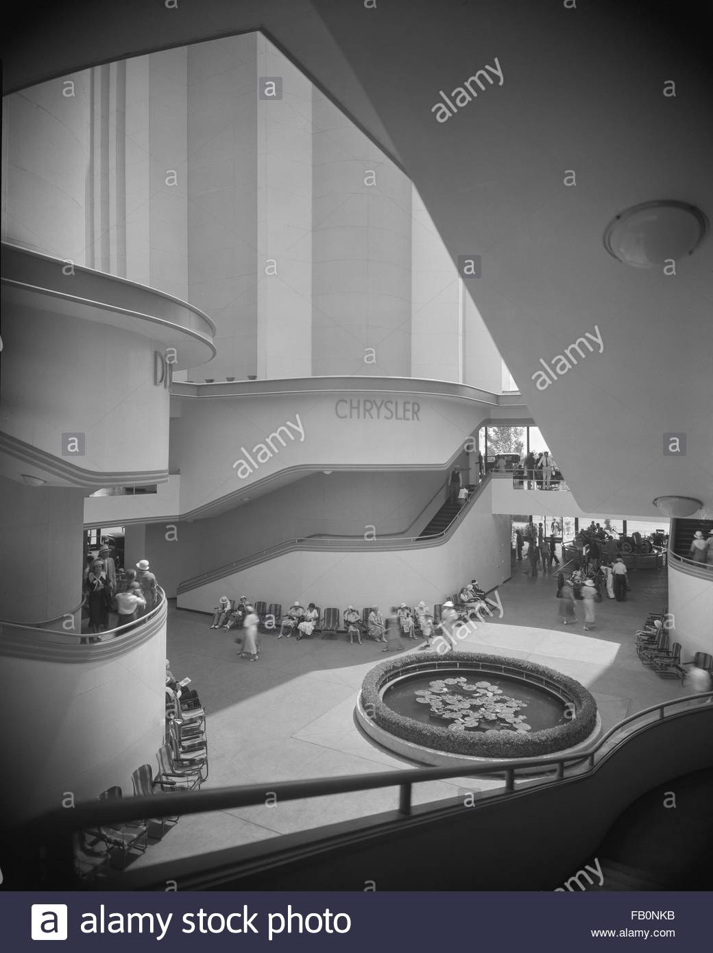 Interior of Chrysler building lobby with people passing through, wide view. Chrysler Motors building at Century - Stock Image