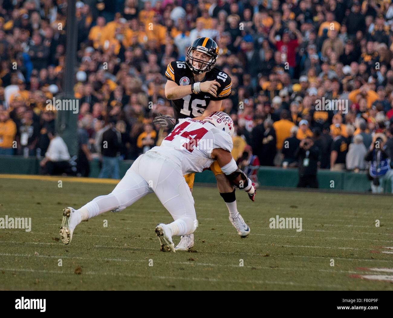 January 1, 2016 Pasadena, CA...Iowa Hawkeyes quarterback (16) C.J. Beathard makes a pass before getting hit by Stanford - Stock Image