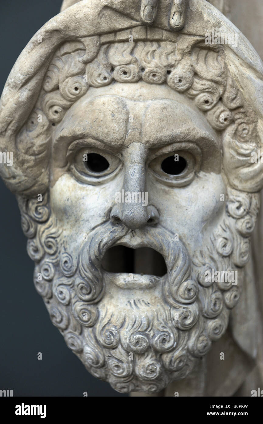 Tragedy mask. Detail of the Melpomene's statue, Muse of singing and Tragedy. Roman statue. 2nd century AD. Marble. - Stock Image