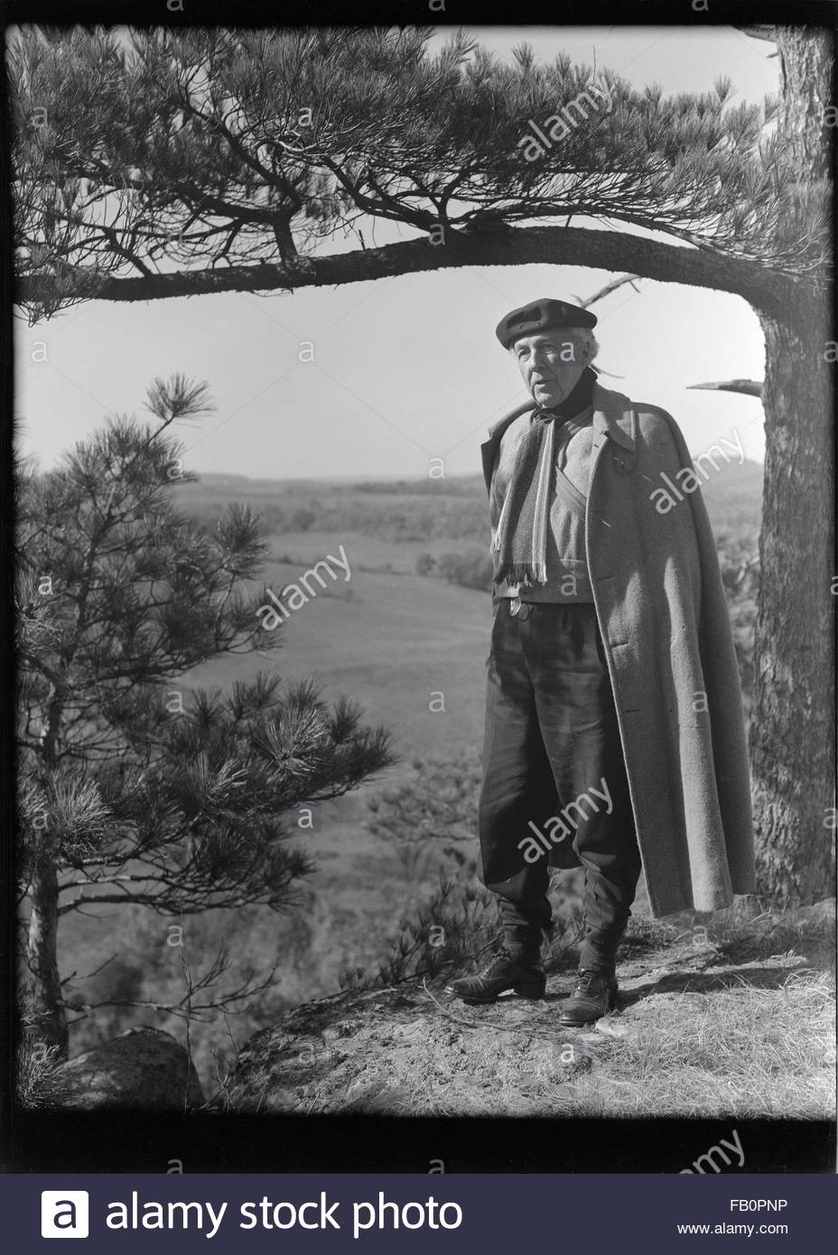 Portraits of Frank Lloyd Wright and others at Taliesin East [graphic], 1937 Dec. Portrait of Wright standing next - Stock Image