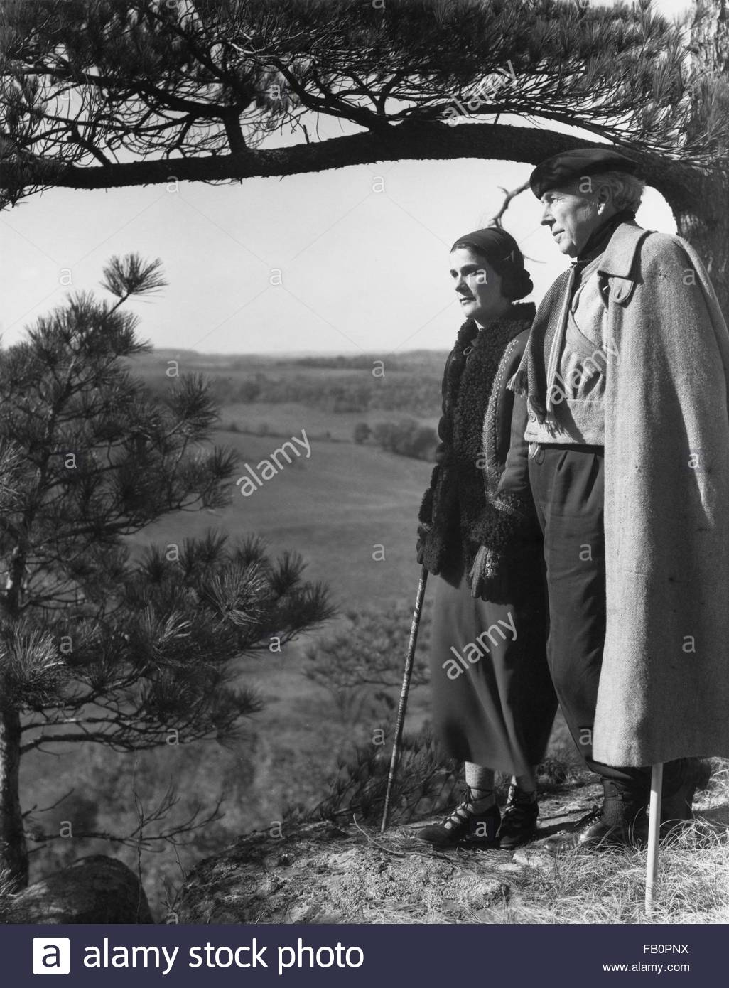 Portraits of Frank Lloyd Wright and others at Taliesin East [graphic], 1937 Dec. Frank Lloyd Wright with his wife, - Stock Image