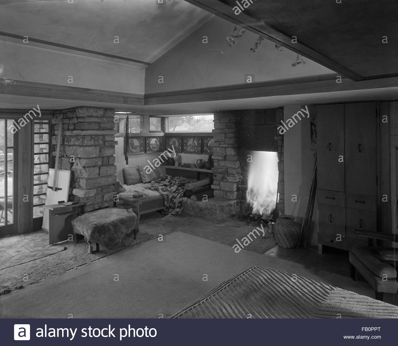 Taliesin East in Spring Green (Wis.), 1937 Dec. Living room corner with fireplace. - Stock Image