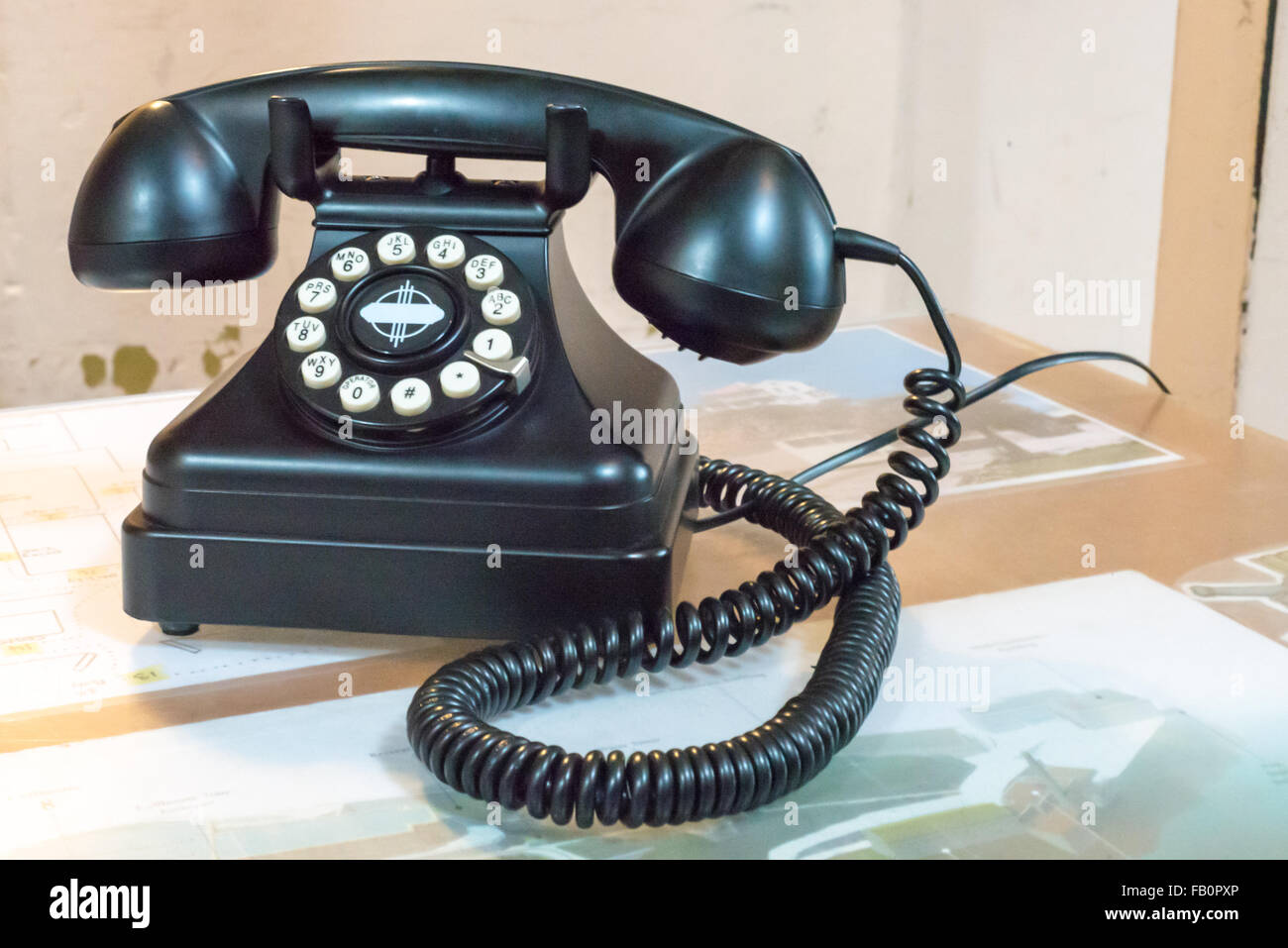 Old black bakelite telephone on a desk in Alcatraz prison - Stock Image