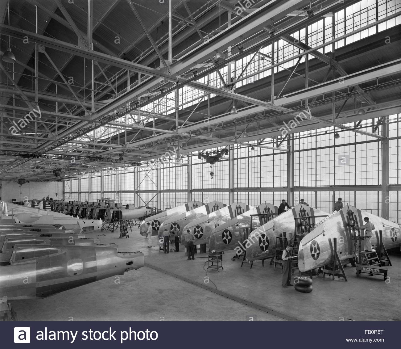 Curtiss-Wright plant in Buffalo (N. Y.), 1939 Apr. 12. Interior, rows of airplane wings. - Stock Image