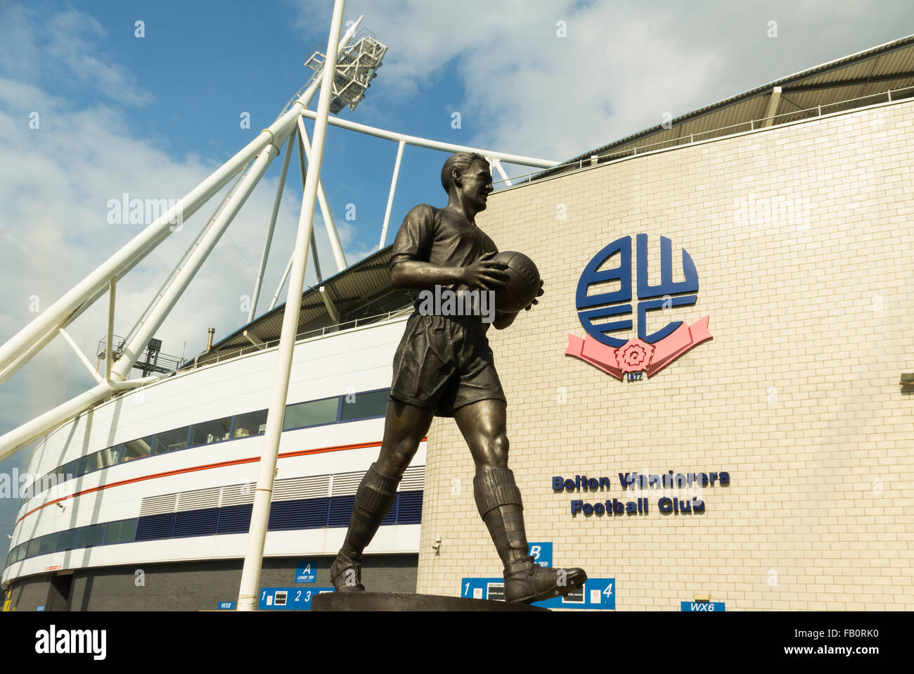 The statue of Bolton Wanderer's most celebrated former player, Nat Lofthouse, stands outside their ground, the Macron Stock Photo