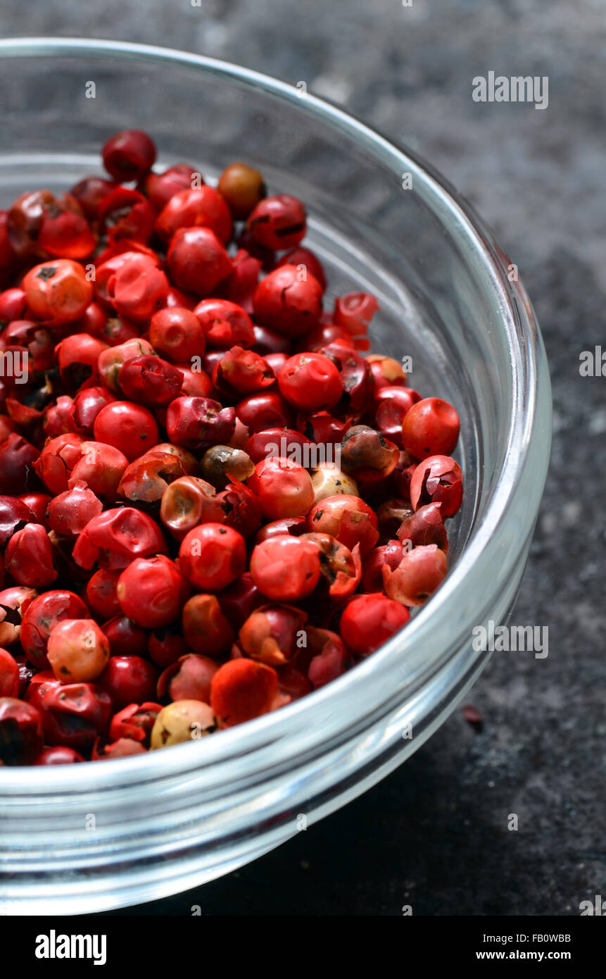 Pink peppercorns, also called 'Brazil Pepper', close up image - Stock Image