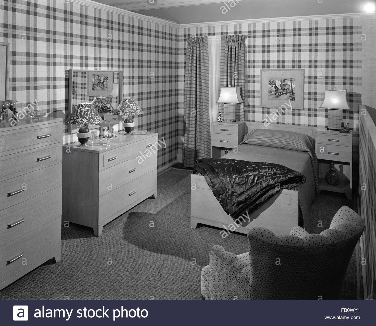 Highway 42 section of Marshall Field and Company furniture department, 1943 Feb. 15. Boys bedroom with plaid wallpaper. Stock Photo