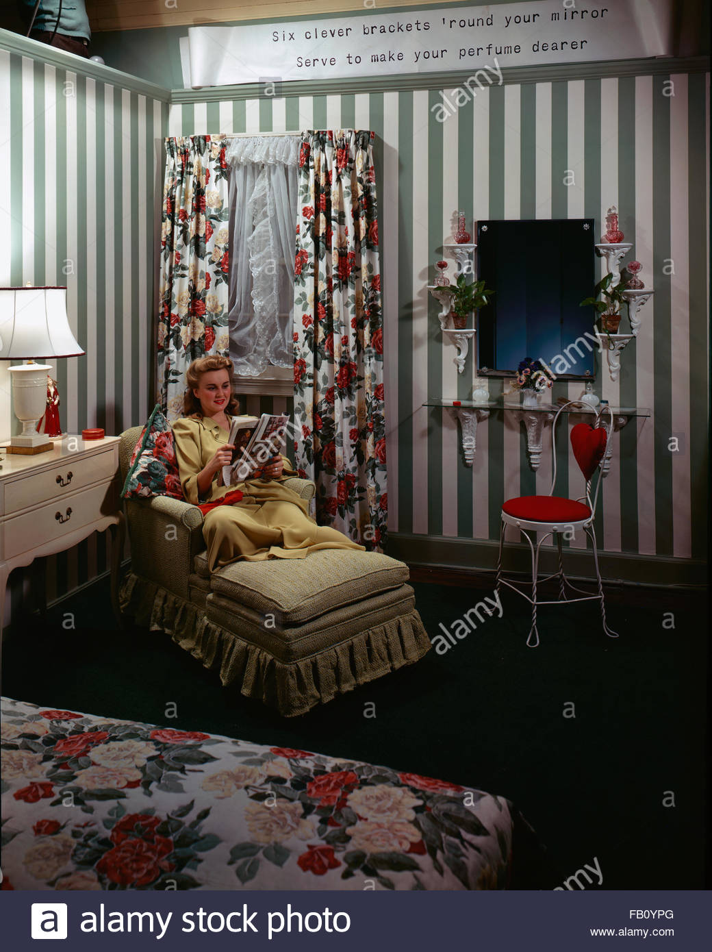 Furniture with model at Marshall Field and, 1943 Dec. 8. Bedroom with woman sitting reading a magazine., Image forms Stock Photo