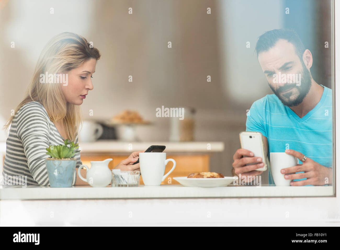 Woman and man using telephones - Stock Image