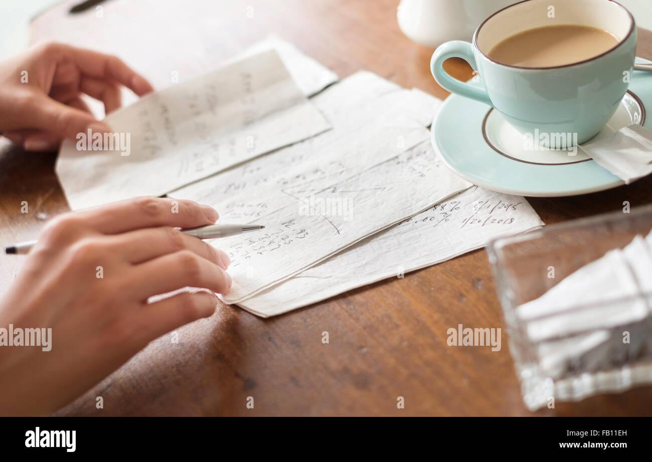 Woman writing on napkins - Stock Image