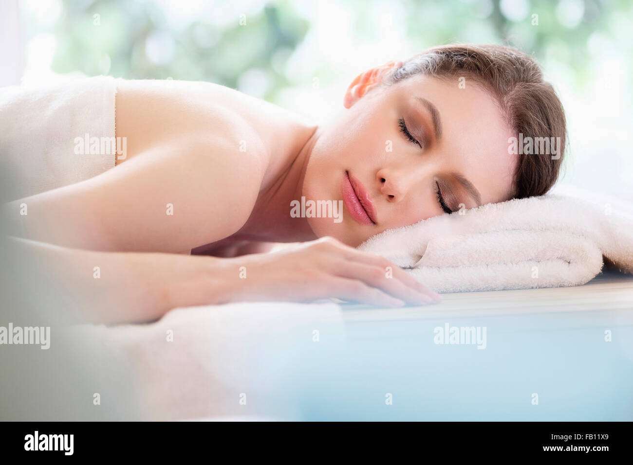 Portrait of beautiful woman in spa - Stock Image