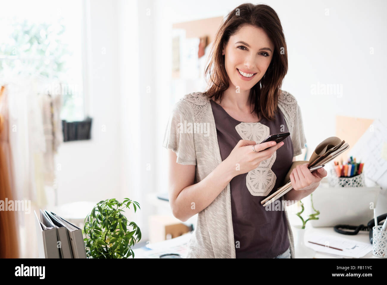 Young woman looking at camera - Stock Image