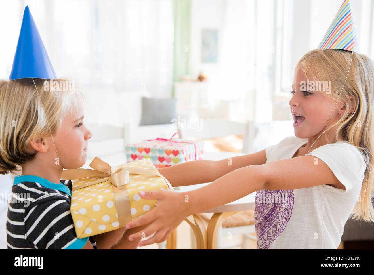 Sister 6 7 Giving Birthday Present To Brother 4 5