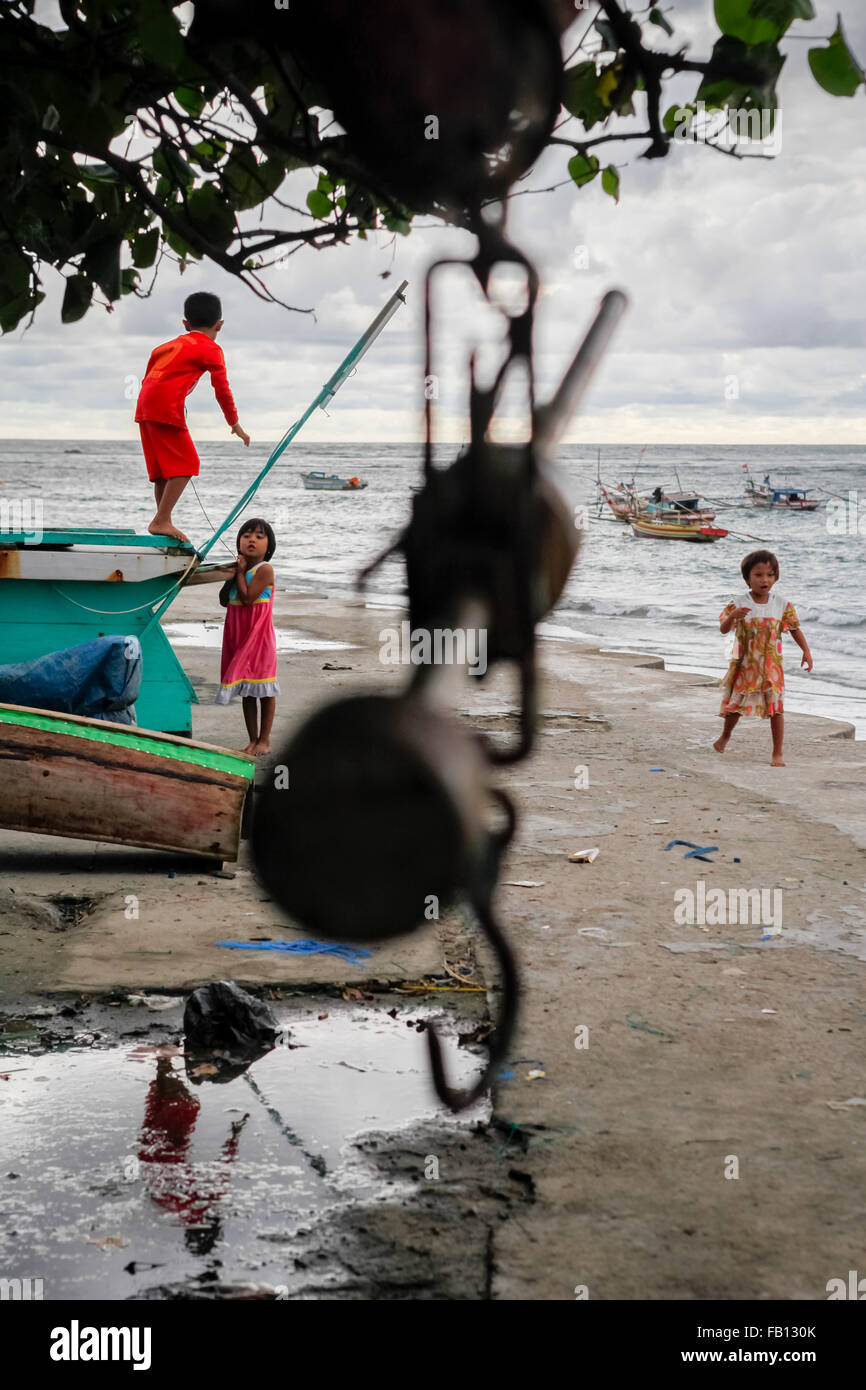 Children playing at fishermen village in Bengkulu, Sumatra, Indonesia. - Stock Image