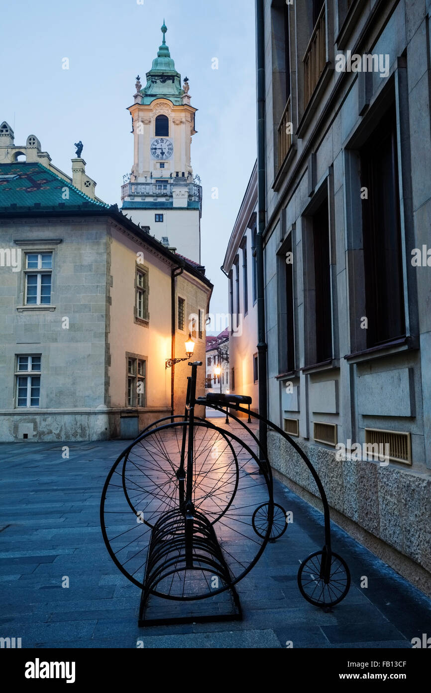 Stationary bicycles with architecture in background - Stock Image