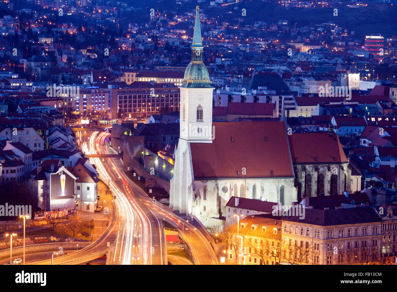 City street and St. Martin's Cathedral at night - Stock Image