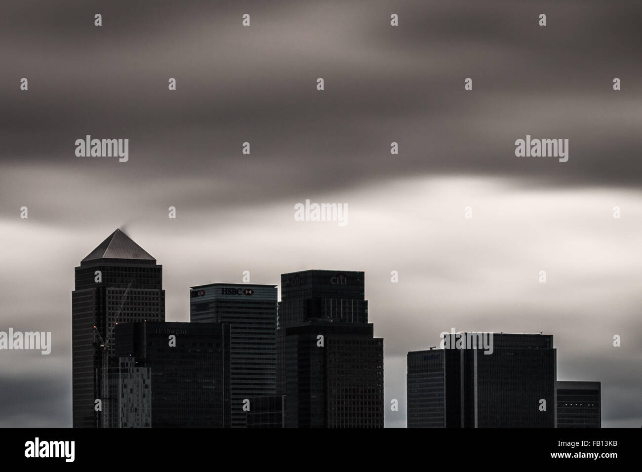 London, UK. 7th January, 2016. UK Weather: Fast cloud and dark skies over Canary Wharf business park buildings Credit: - Stock Image