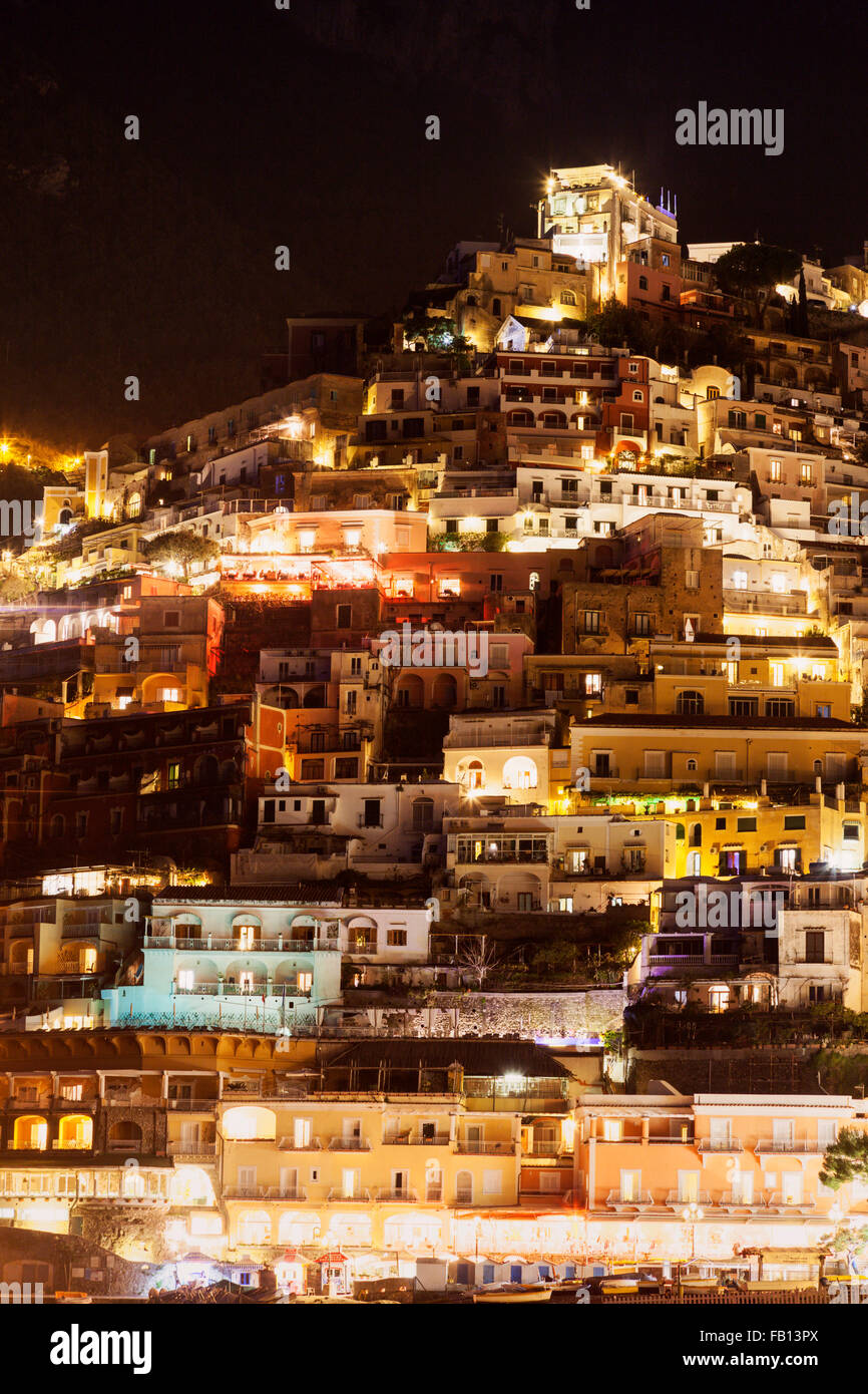 Residential buildings on hill at night - Stock Image