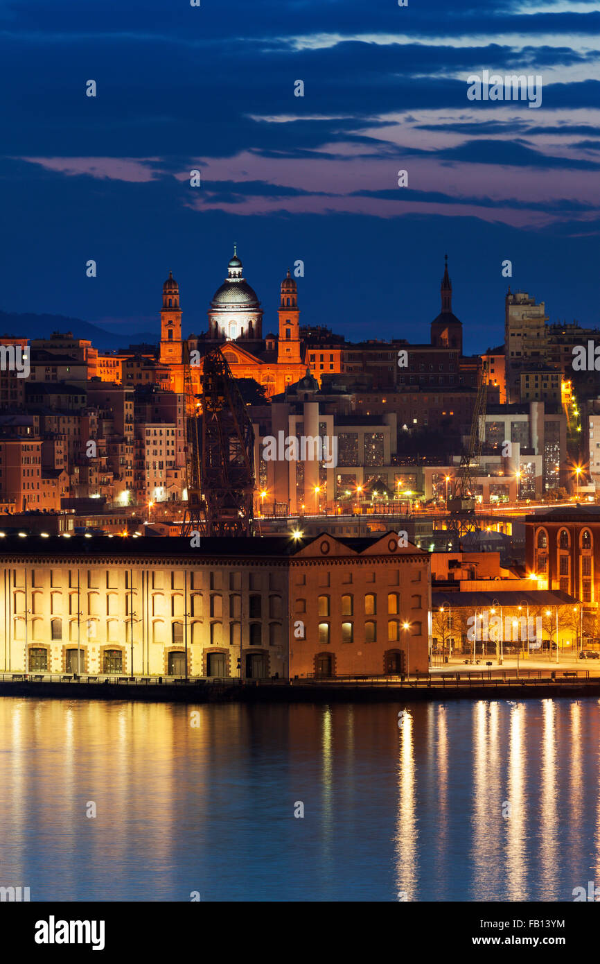 Old town in Genoa across harbor - Stock Image