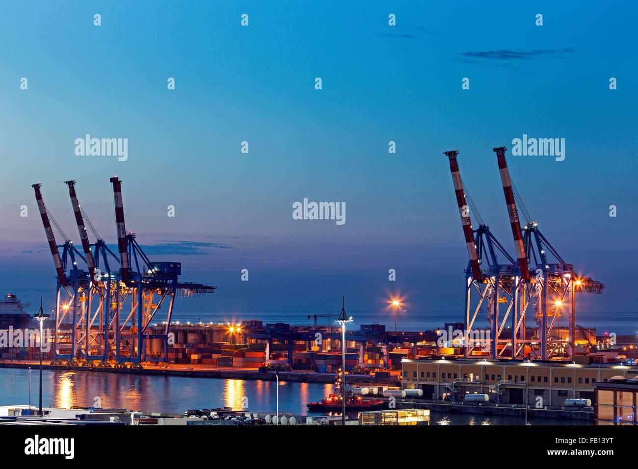 Genoa harbor cranes at sunrise - Stock Image