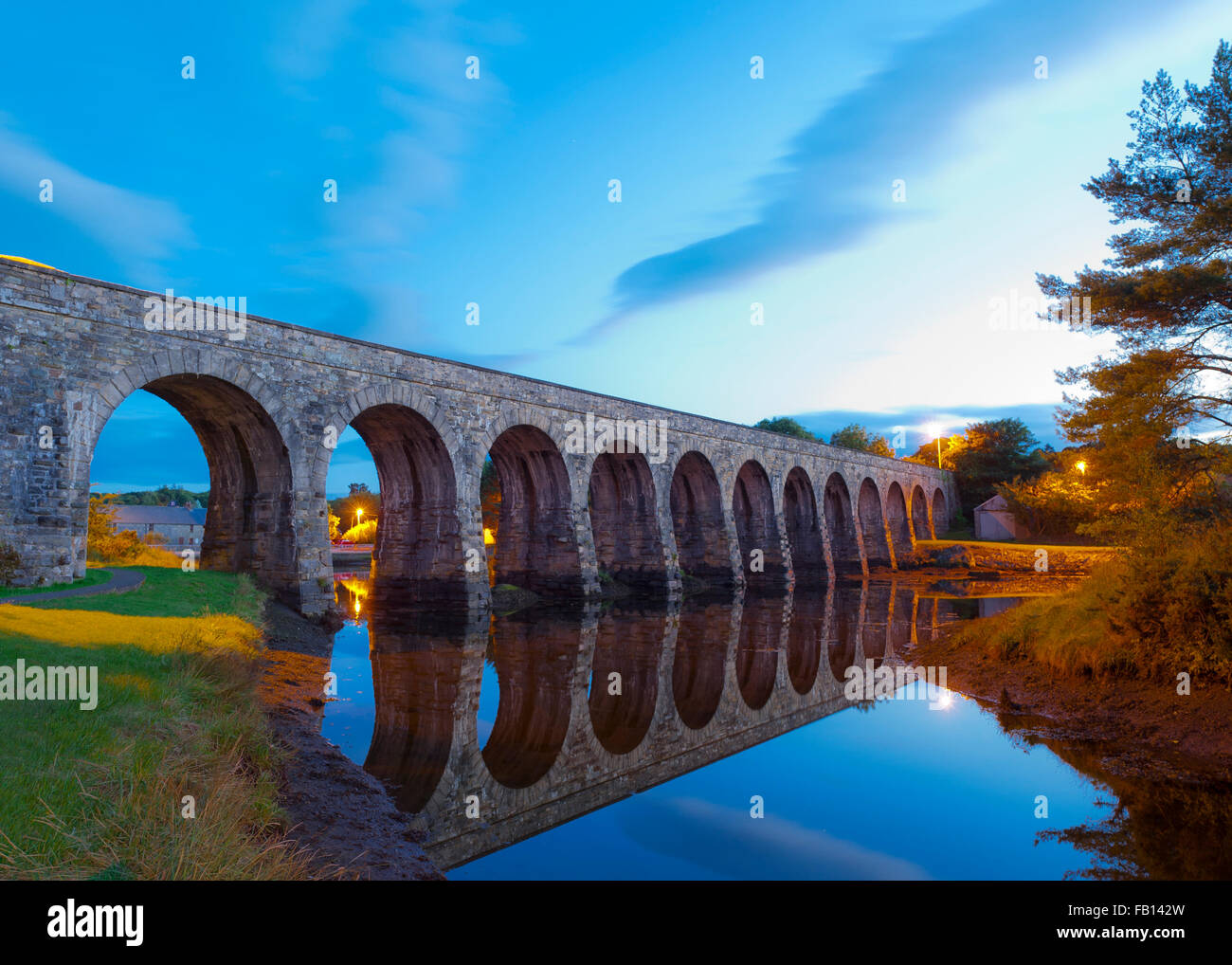 The famous 12 Arch Bridge in Ballydehob, West Cork, Ireland at sunset with copy space. - Stock Image