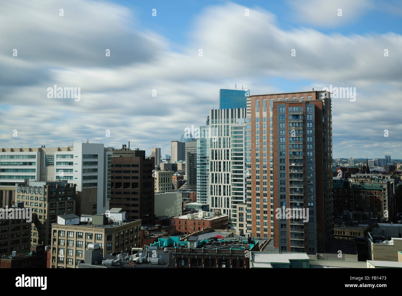 Clouds over modern city - Stock Image