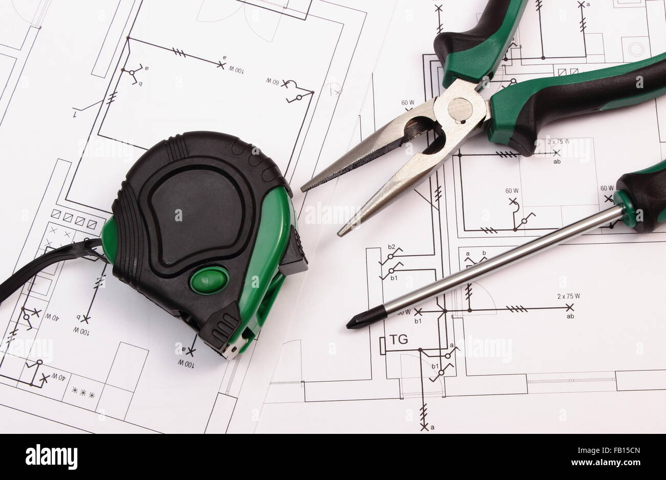 Metal pliers screwdriver and tape measure on electrical metal pliers screwdriver and tape measure on electrical construction drawing of house work tools ccuart Image collections