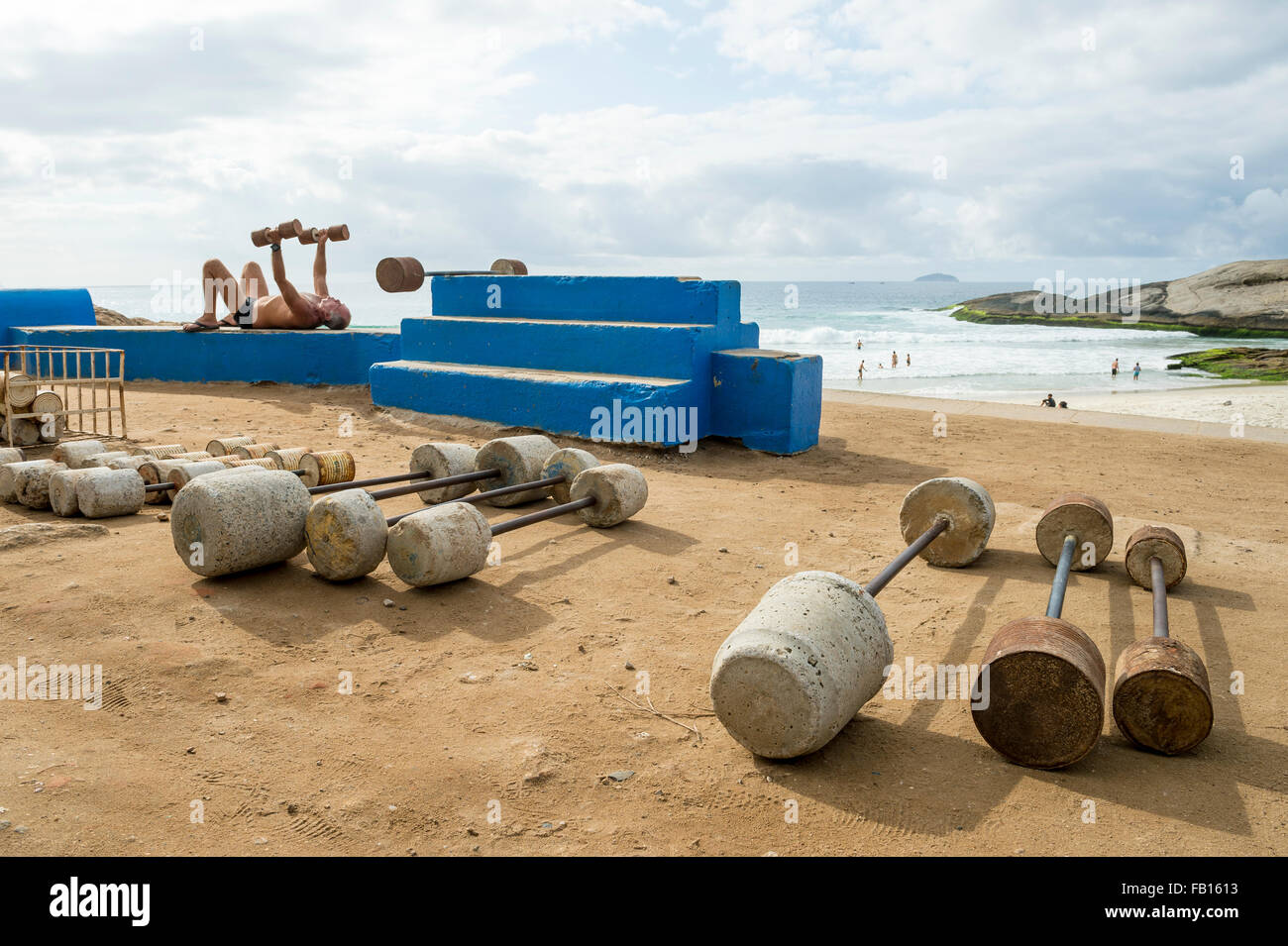 RIO DE JANEIRO, BRAZIL - FEBRUARY 12, 2015: Brazilian man exercises at the outdoor workout station at Arpoador, - Stock Image