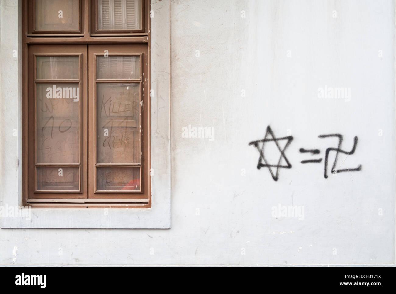 Anti semitic graffiti (Star of David and Swastika) on house wall. - Stock Image