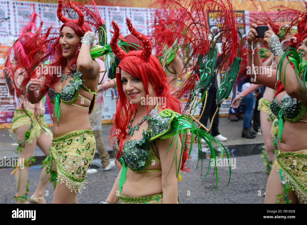 Dancers in green, at Notting Hill carnival.London, England. - Stock Image