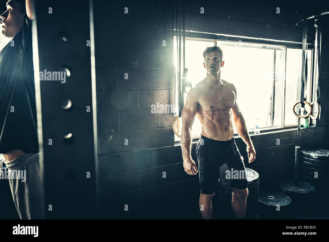 Men training in gym - Stock Image