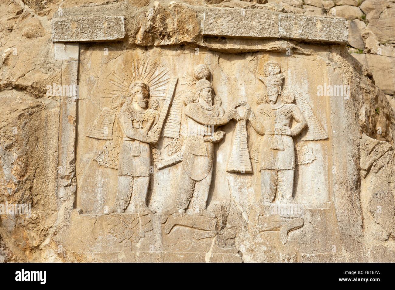 Rock relief from the Sassanid Empire, coronation ceremony, investiture, God Mithras, Persian ruler King Ardashir - Stock Image